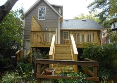 New wood deck built on the back of a house after a fire