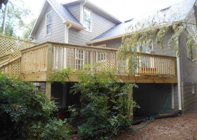 New wood deck built onto the back of a house after a fire