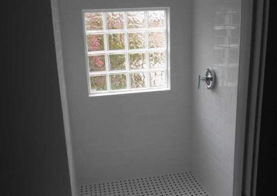 Renovated shower with new tile after a file damage