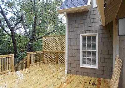 New wood deck on the back of a house that was damaged by fire