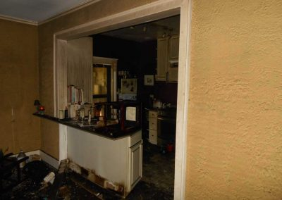 Kitchen area badly damaged from a fire