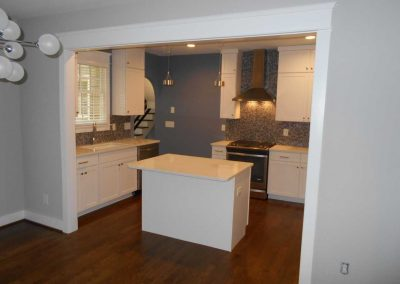 New kitchen island and white cabinets after a fire destroyed this kitchen