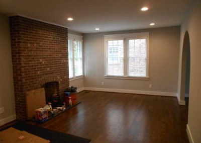 Renovated living room with fireplace after a fire damage