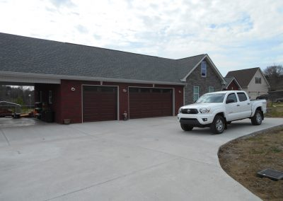 Brick two-car garage that was rebuilt after a complete fire loss